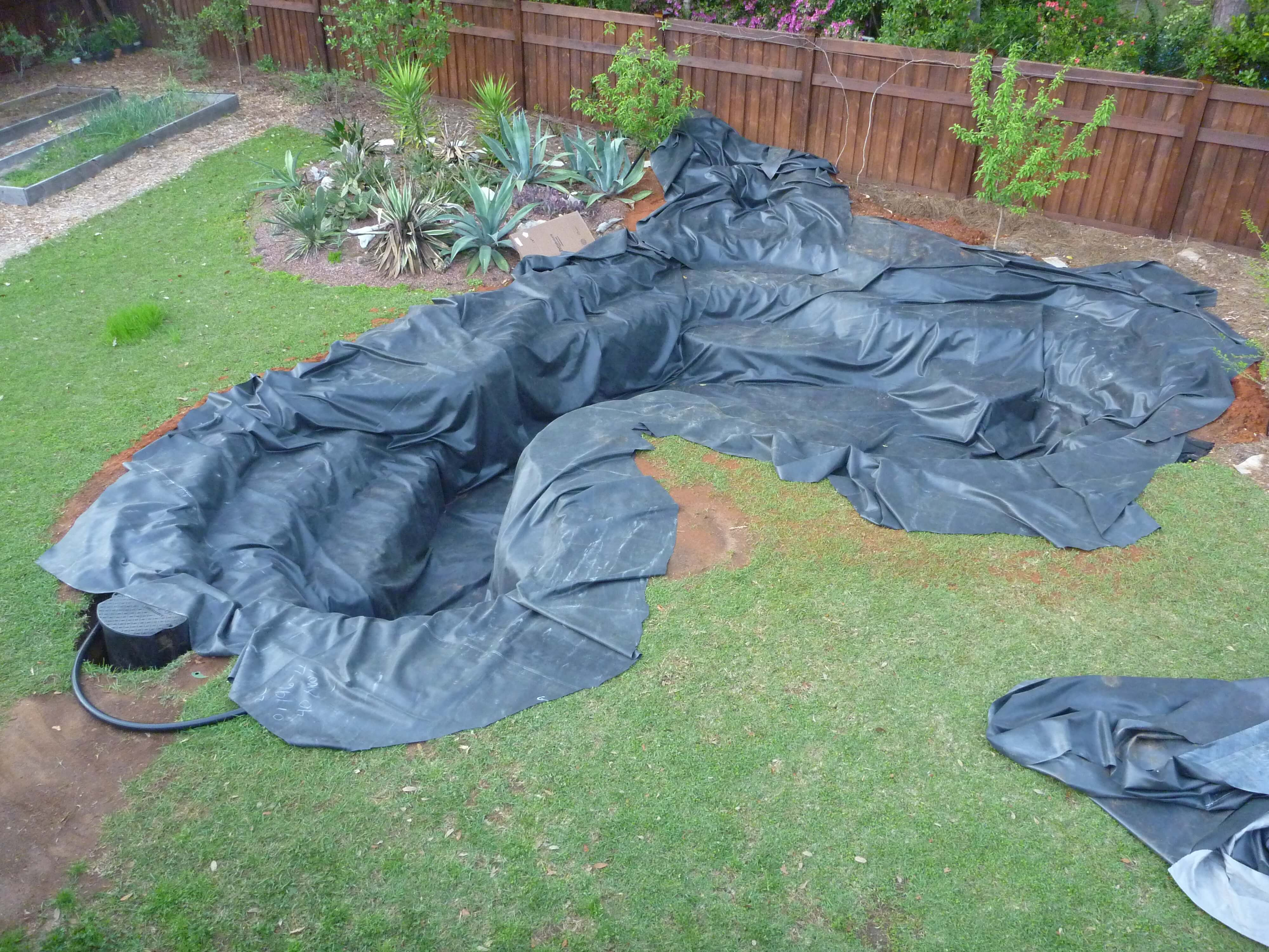 Part 5 pond construction koi tunnel underlayment pond for Koi pool liners